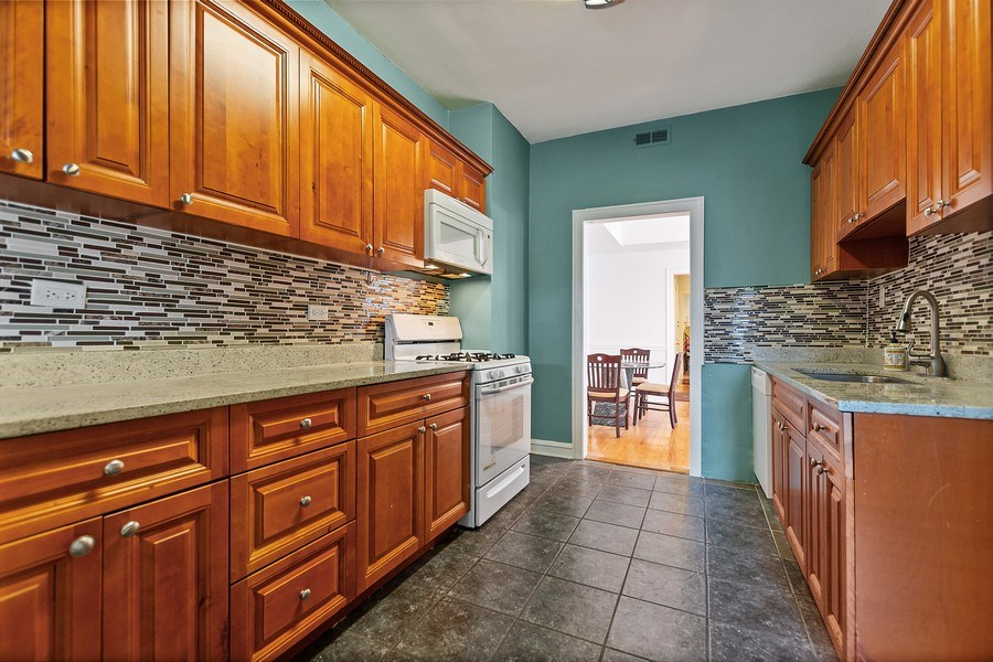 Real Estate Photography - 4114 N Kedzie Ave, Chicago, IL, 60618 - Kitchen