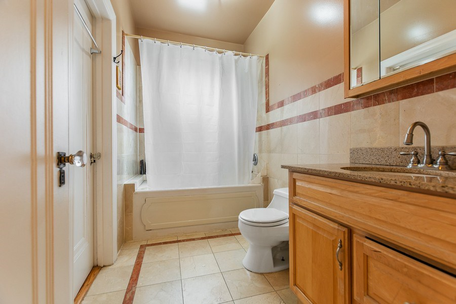Real Estate Photography - 4114 N Kedzie Ave, Chicago, IL, 60618 - Bathroom