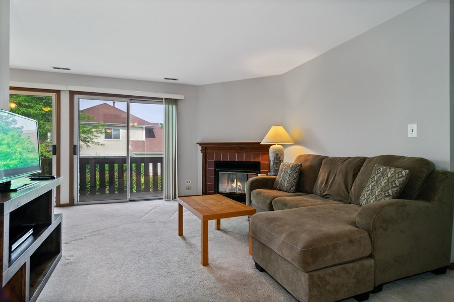 Real Estate Photography - 341 Newport Ln, Unit C2, Bartlett, IL, 60103 - Living Room