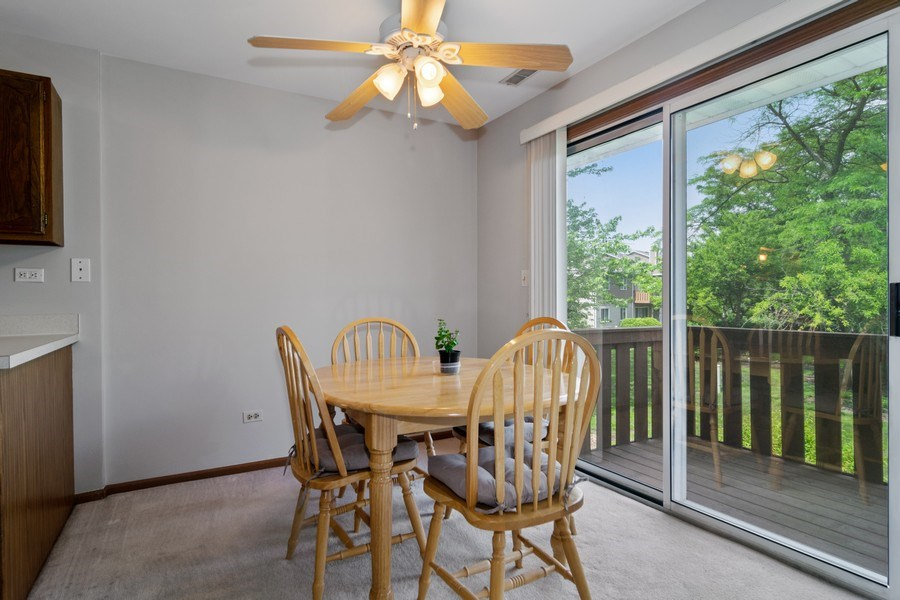 Real Estate Photography - 341 Newport Ln, Unit C2, Bartlett, IL, 60103 - Dining Room