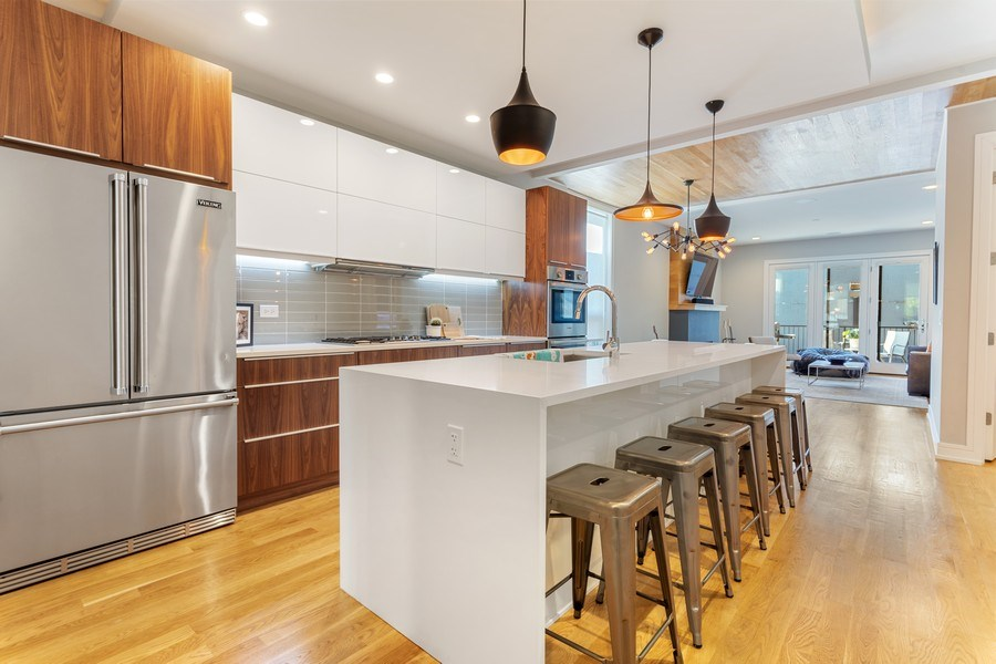 Real Estate Photography - 2435 W Homer, Unit 1E, Chicago, IL, 60647 - Kitchen w/ over sized quartz waterfall island