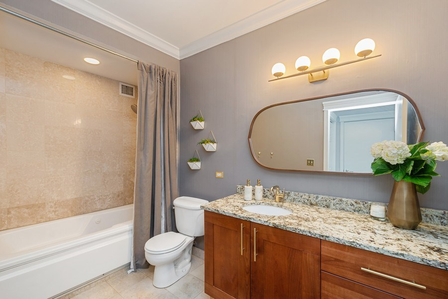 Real Estate Photography - 744 N. Clark St., Apt. 304, Chicago, IL, 60654 - Master Bathroom