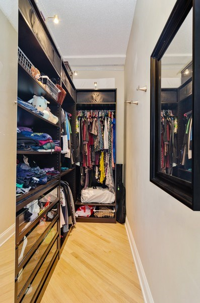 Real Estate Photography - 600 South Dearborn #1402, Chicago, IL, 60605 - Master Bedroom Closet