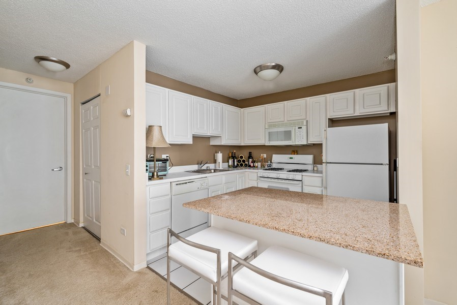 Real Estate Photography - 545 Dearborn, Unit W1606, Chicago, IL, 60654 - Kitchen