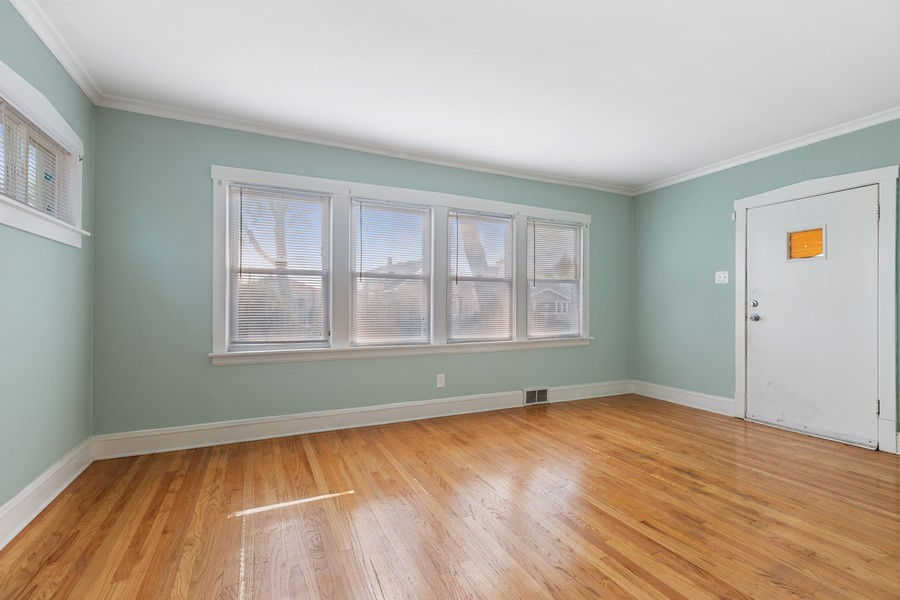Real Estate Photography - 627 24th Ave, Bellwood, IL, 60104 - Living Room