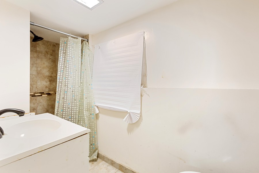 Real Estate Photography - 627 24th Ave, Bellwood, IL, 60104 - 2nd Bathroom