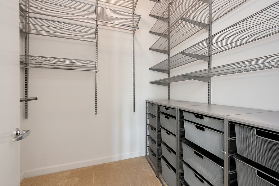Real Estate Photography - 1111 S State Street, Unit A702, Chicago, IL, 60605 - Master Bedroom Closet