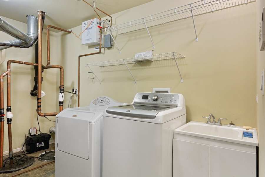 Real Estate Photography - 2712 N Lehmann Ct, Unit 1S, Chicago, IL, 60614 - Laundry Room