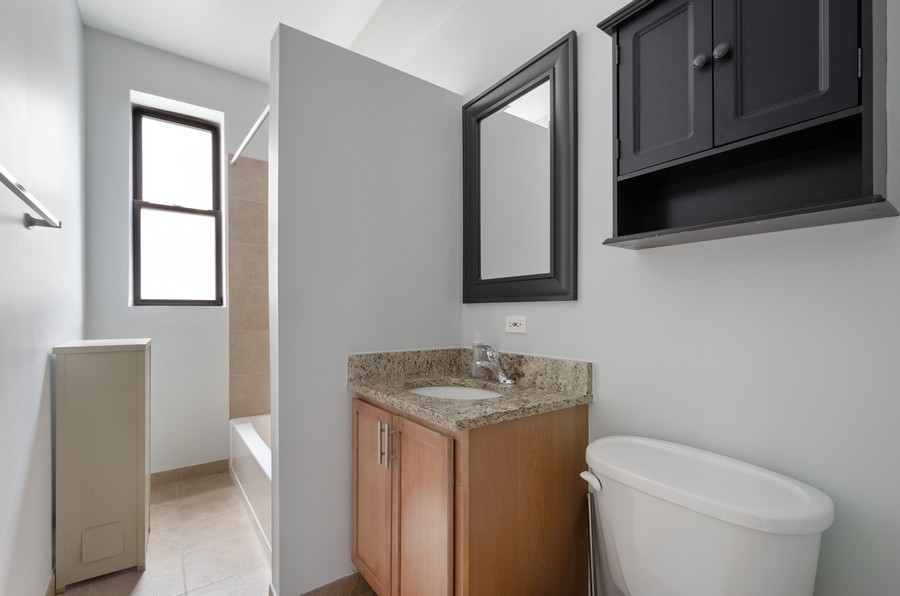 Real Estate Photography - 1522 W Belle Plaine, Unit #1, Chicago, IL, 60613 - Master Bathroom