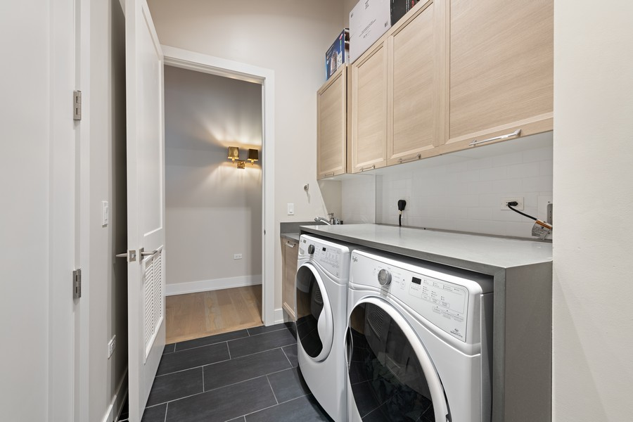 Real Estate Photography - 676 N Kingsbury, Unit 204, Chicago, IL, 60654 - Laundry Room