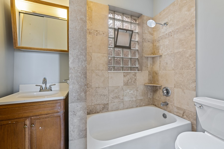 Real Estate Photography - 4413 W Montrose 3, Chicago, IL, 60641 - Bathroom