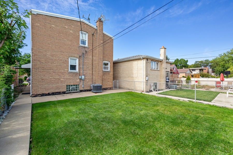 Real Estate Photography - 5727 S Austin Avenue, Chicago, IL, 60638 - Rear View