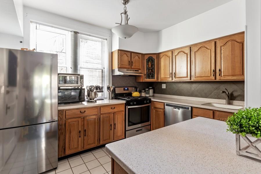 Real Estate Photography - 545 W. Addison St., Unit 1, Chicago, IL, 60613 - Kitchen