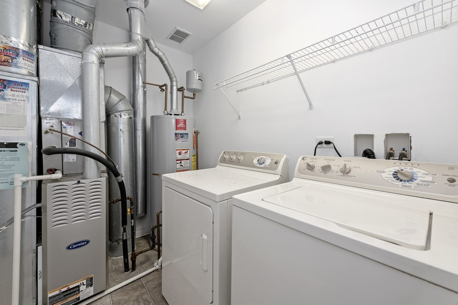 Real Estate Photography - 718 S Jade Ln, Rolling Meadows, IL, 60073 - Laundry Room