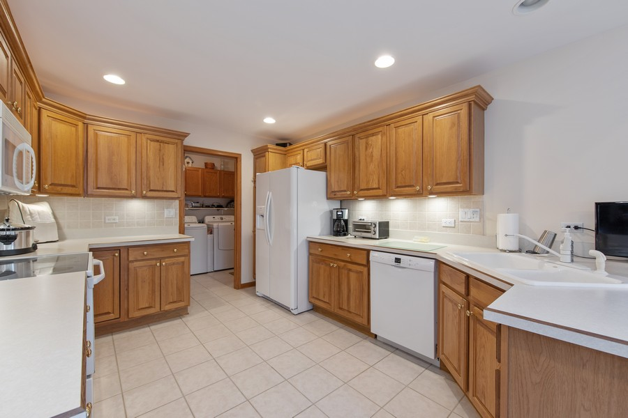 Real Estate Photography - 12219 Spire Drive, Lemont, IL, 60439 - Kitchen with Laundry view