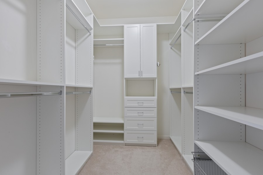 Real Estate Photography - 945 Burlington Ave, Unit 404, Downers Grove, IL, 60515 - Master Bedroom Closet