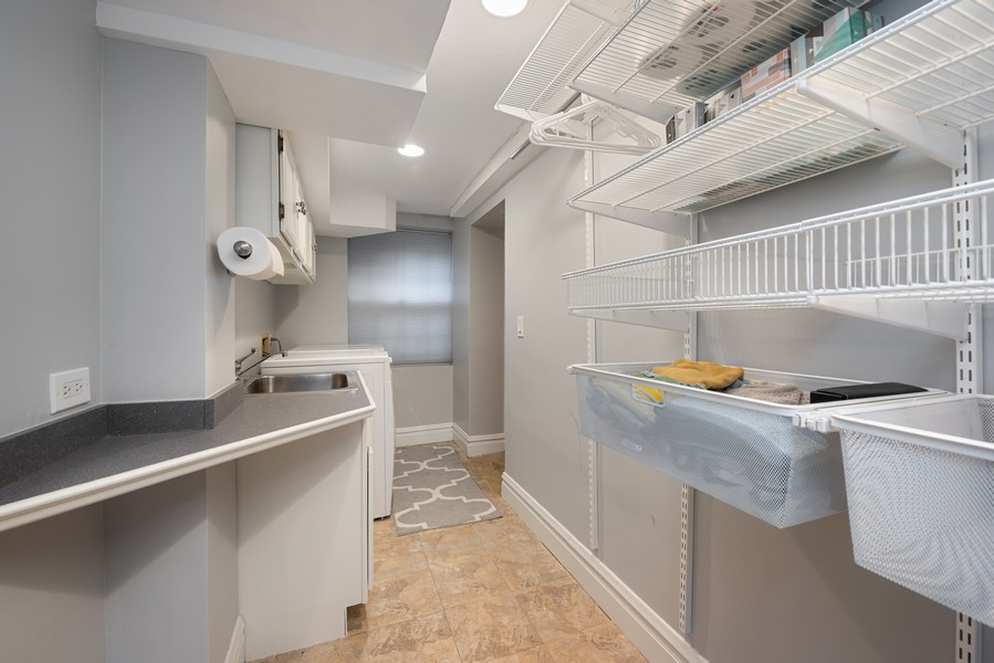 Real Estate Photography - 4902 N Hermitage Ave, Unit 1, Chicago, IL, 60640 - Laundry Room