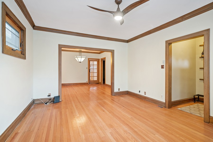 Real Estate Photography - 3655 N Artesian, Chicago, IL, 60618 - Living Room with view into Dining Room
