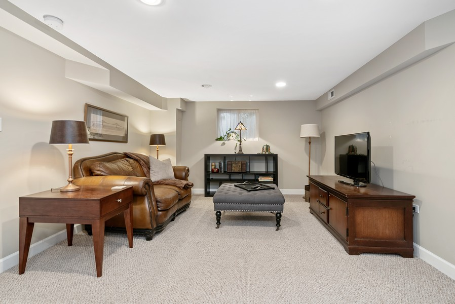Real Estate Photography - 3655 N Artesian, Chicago, IL, 60618 - Lower level Family Room