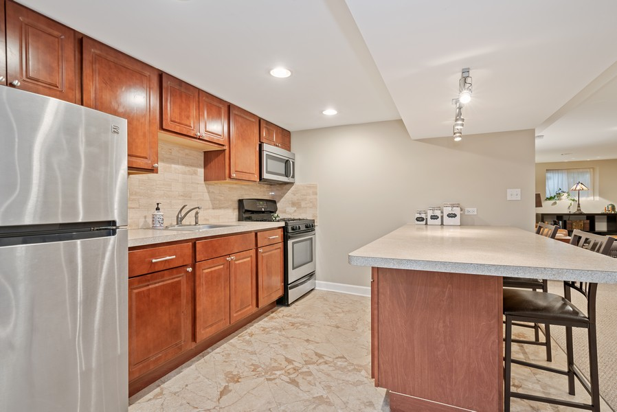 Real Estate Photography - 3655 N Artesian, Chicago, IL, 60618 - Lower Level Kitchen with Island