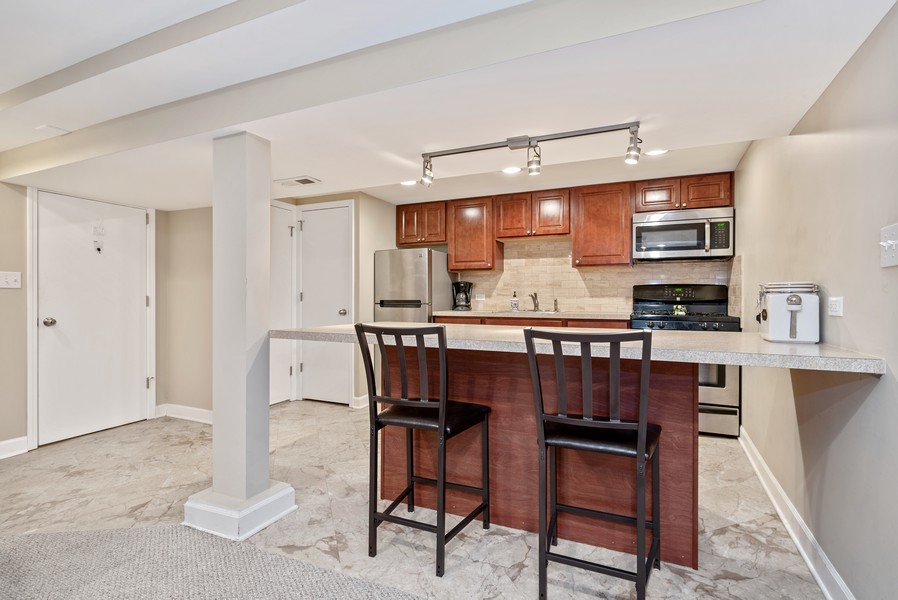 Real Estate Photography - 3655 N Artesian, Chicago, IL, 60618 - Lower Level Kitchen