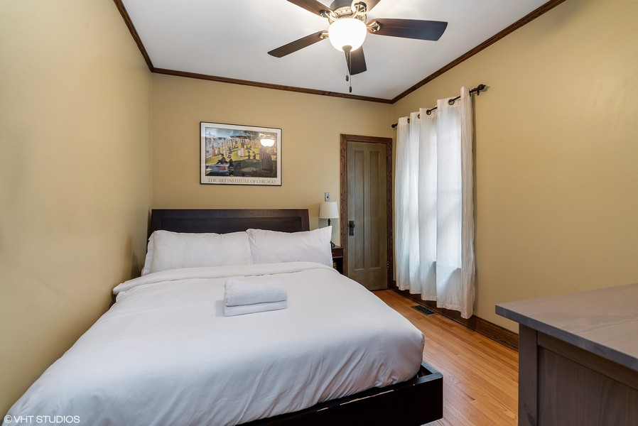 Real Estate Photography - 3655 N Artesian, Chicago, IL, 60618 - Main level 2nd Bedroom with closet
