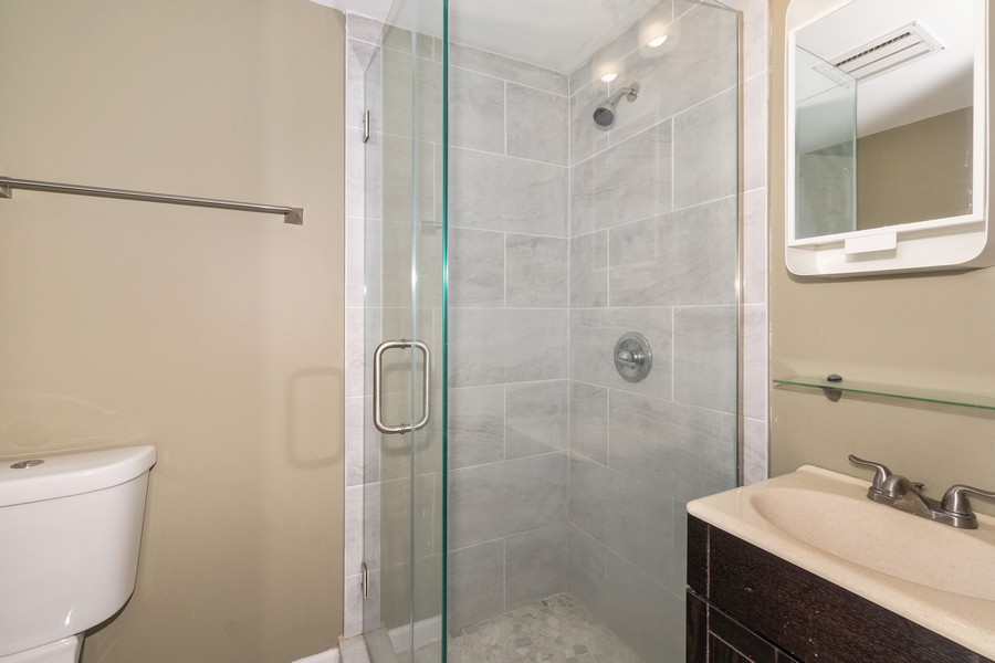 Real Estate Photography - 8 Belair Road, Selden, NY, 11784 - Guest Room Ensuite Bath