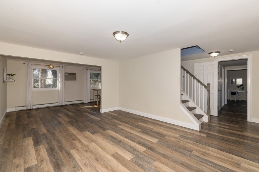 Real Estate Photography - 8 Belair Road, Selden, NY, 11784 - Spacious Living Room w/Easy Flow Throughout