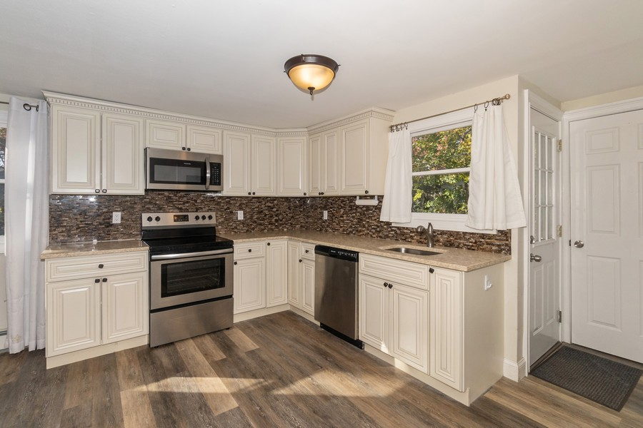 Real Estate Photography - 8 Belair Road, Selden, NY, 11784 - Spacious Kitchen w/access to Outdoor Living