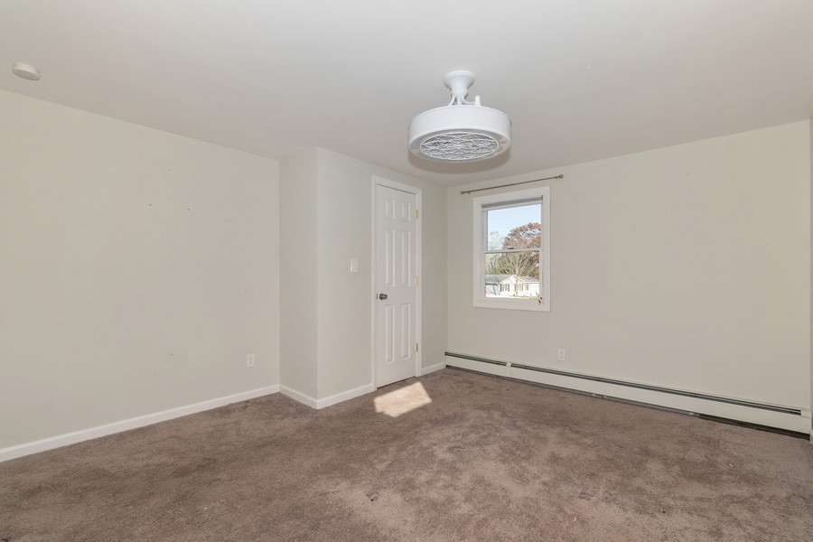 Real Estate Photography - 8 Belair Road, Selden, NY, 11784 - Master Bedroom and Walk-In Closet