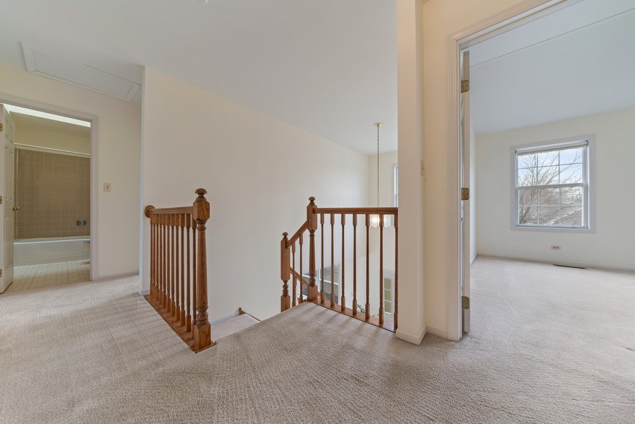 Real Estate Photography - 175 Meadowview Ln., Aurora, IL, 60502 - 2nd Floor Corridor