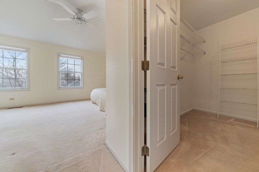 Real Estate Photography - 175 Meadowview Ln., Aurora, IL, 60502 - Master Bedroom Closet