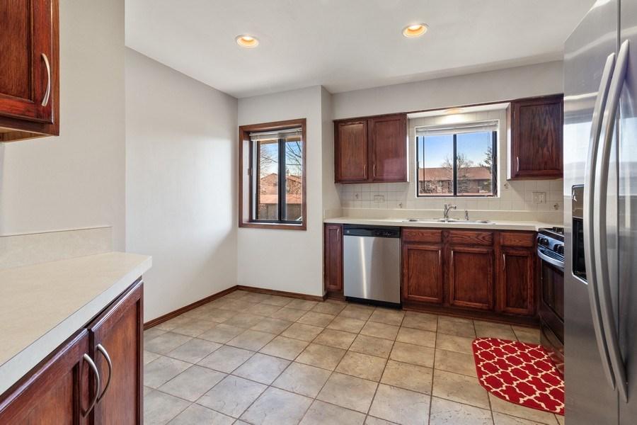Real Estate Photography - 2212 Wharf Dr Apt 2107, Woodridge, IL, 60517 - Kitchen
