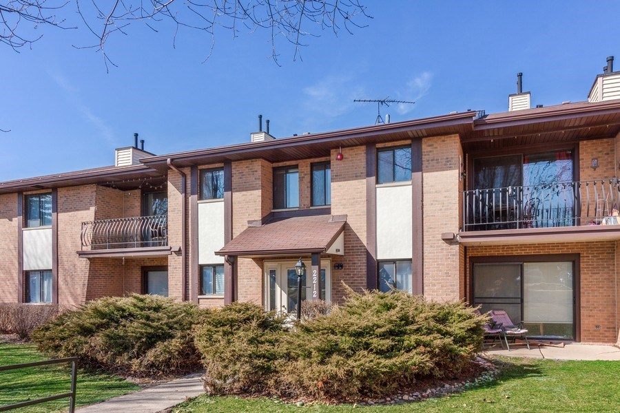 Real Estate Photography - 2212 Wharf Dr Apt 2107, Woodridge, IL, 60517 - Front View