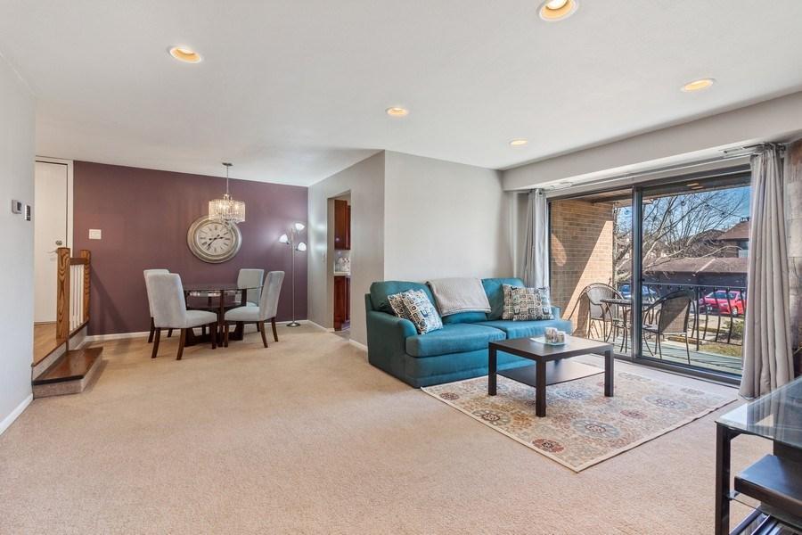 Real Estate Photography - 2212 Wharf Dr Apt 2107, Woodridge, IL, 60517 - Living Room / Dining Room