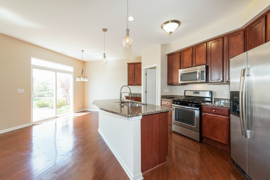 Real Estate Photography - 1271 Church Court, Aurora, IL, 60502 - Kitchen / Dining Room