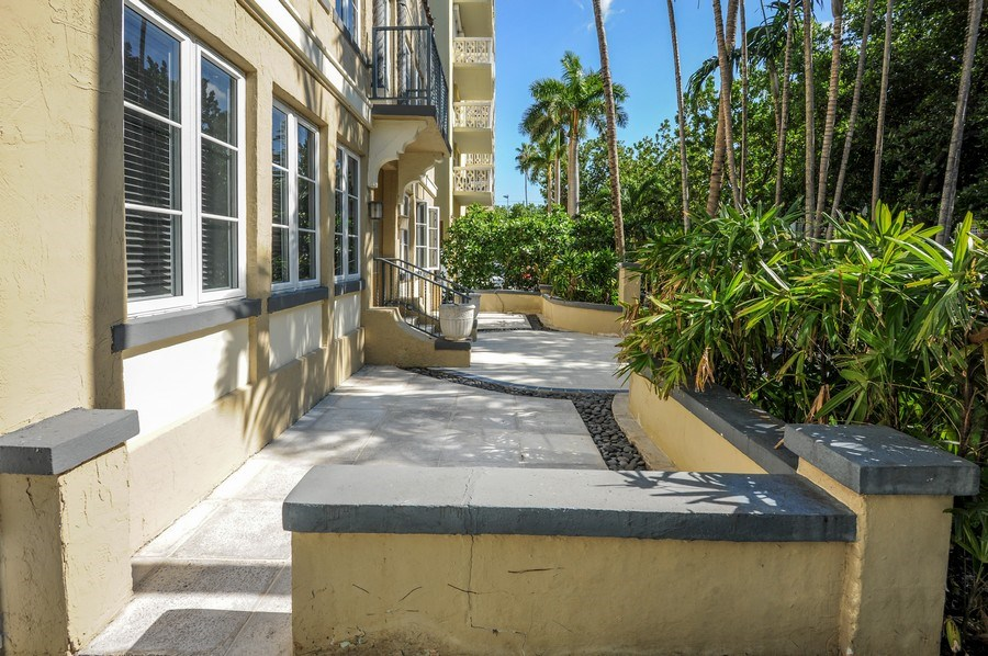 Real Estate Photography - 1018 Meridian Ave, #1, Miami Beach, FL, 33139 - Side View of Building Terrace & Entry