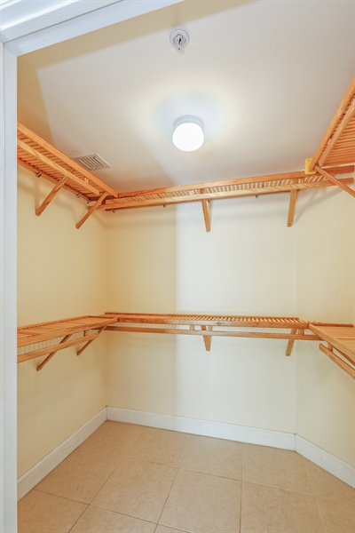 Real Estate Photography - 7604 SW 102nd St, 123, Pinecrest, FL, 33156 - Master Bedroom Walk-in Closet