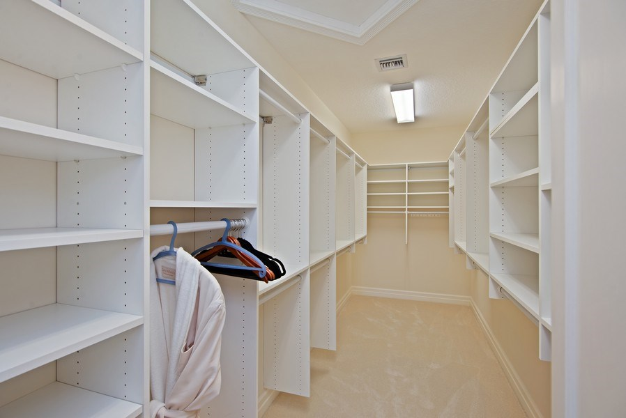 Real Estate Photography - 3231 Tidegate Circle, Jupiter, FL, 33477 - Master Bedroom Closet