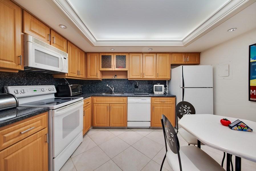 Real Estate Photography - 100 Worth Avenue, #220, Palm Beach, FL, 33480 - Kitchen / Breakfast Room