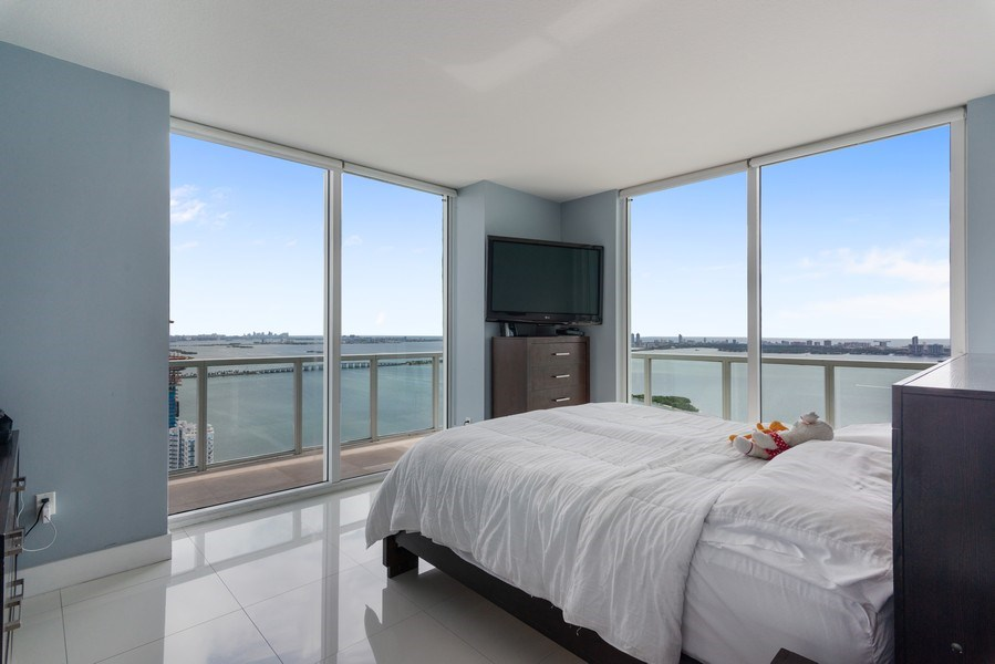 Real Estate Photography - 1900 N. Bayshore Drive, #4802, Miami, FL, 33132 - Master Bedroom & Balcony