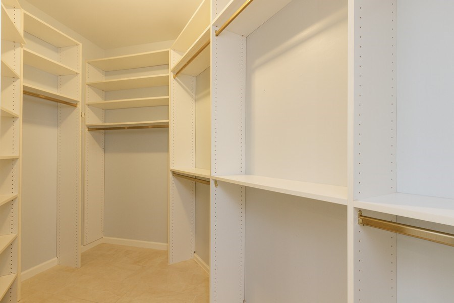 Real Estate Photography - 6436 Via Rosa, Boca Raton, FL, 33433 - Master Bedroom Closet