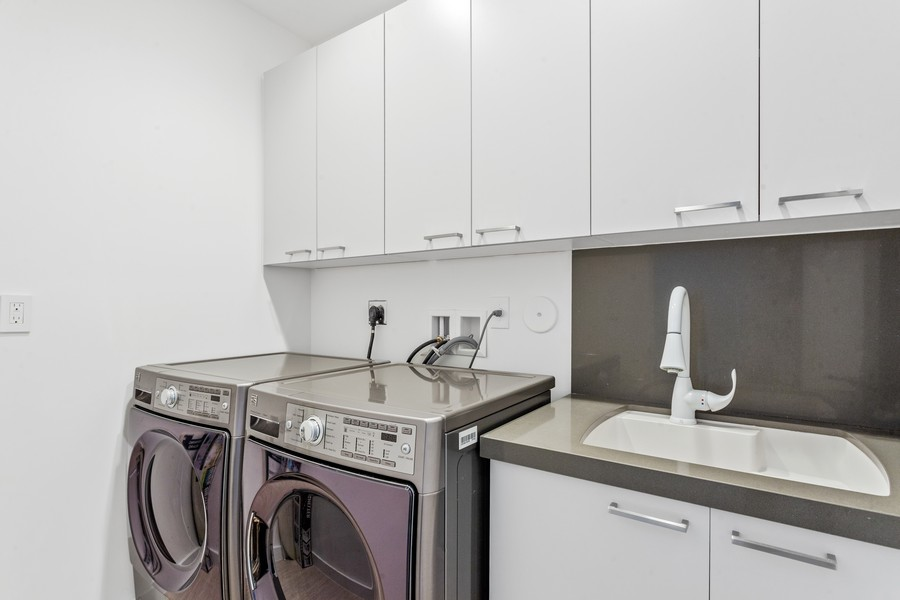 Real Estate Photography - 2401 N. Atlantic Blvd.,, Fort Lauderdale, FL, 33305 - Laundry Room