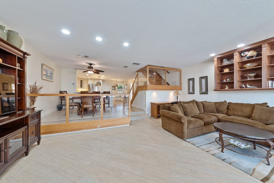 Real Estate Photography - 1055 Boca Cove Lane, Highland Beach, FL, 33487 - Living Room / Dining Room