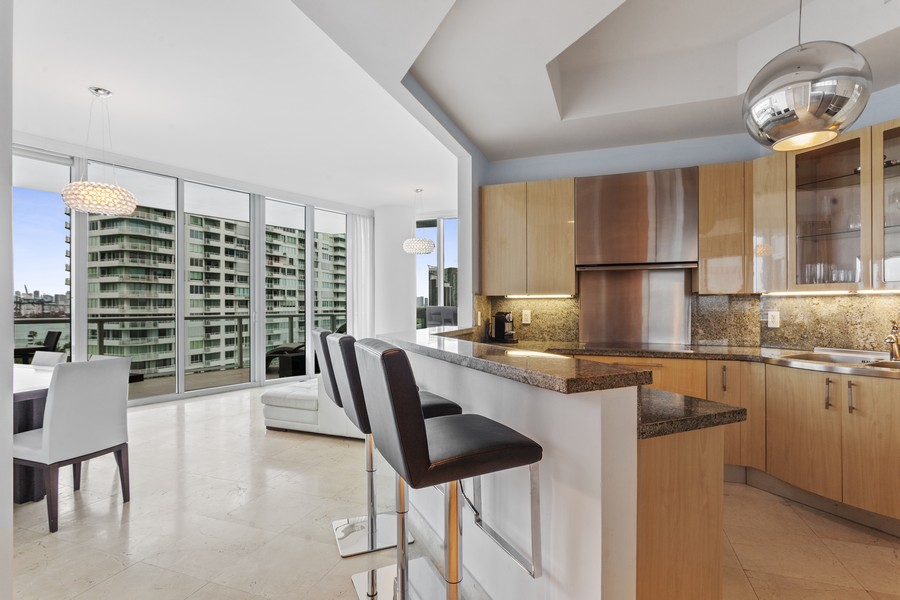 Real Estate Photography - 100 S Pointe Dr, Miami beach, FL, 33139 - Kitchen / Dining Room