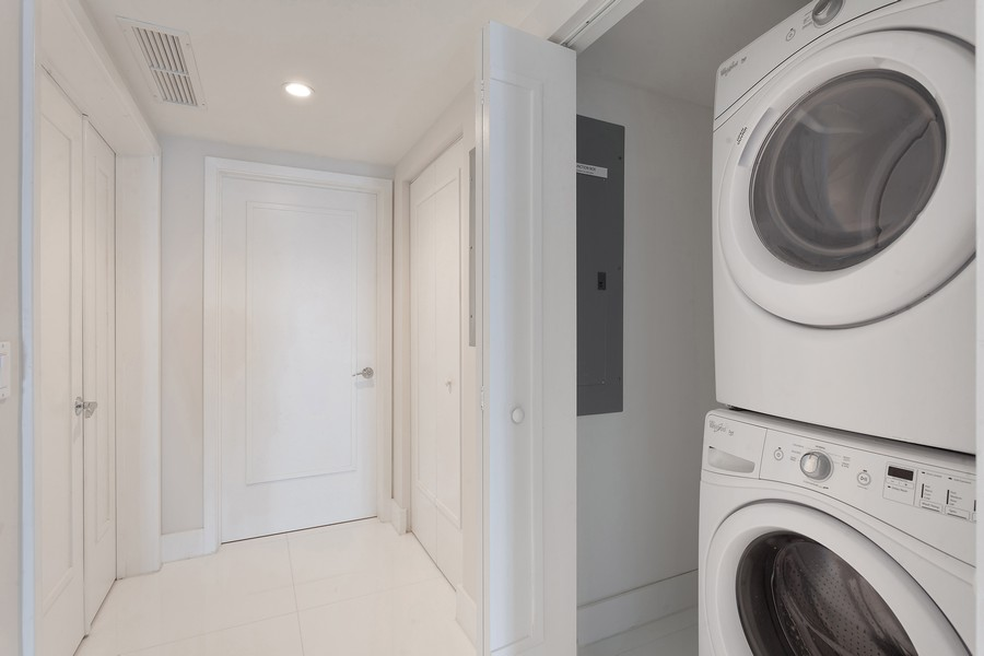 Real Estate Photography - 9400 W. Bay Harbor Drive, #504, Bay Harbor Islands, FL, 33154 - Laundry Room