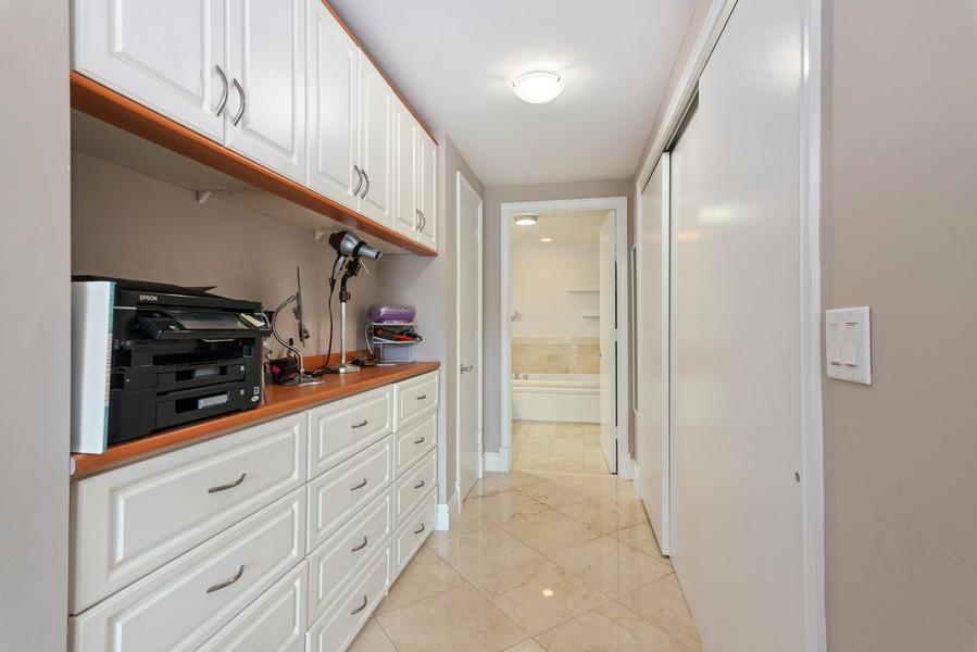 Real Estate Photography - 3400 SW 27th Avenue, #1104, Miami, FL, 33133 - Master Bedroom Closet