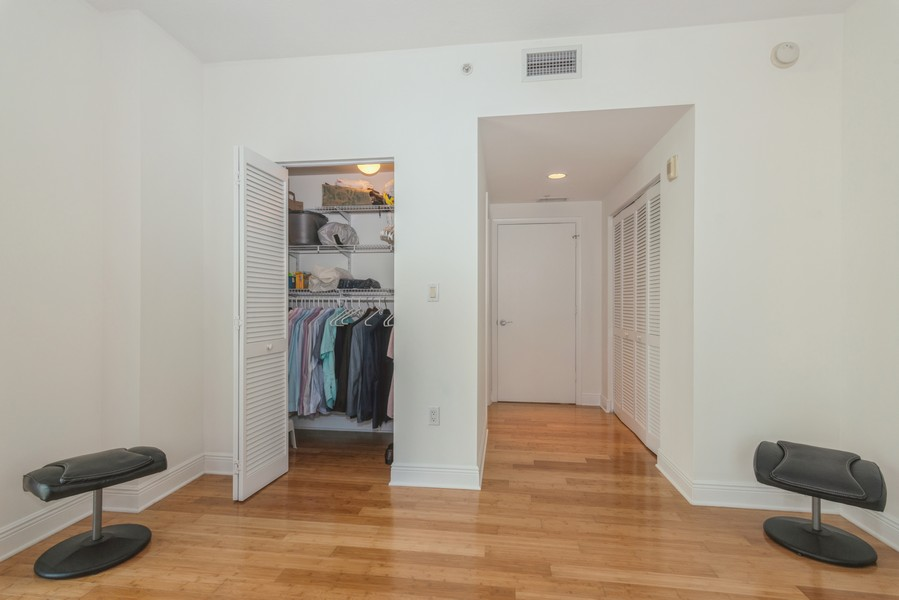 Real Estate Photography - 7285 SW 90th St, Unit D613, Miami, FL, 33156 - Primary Bedroom Closet