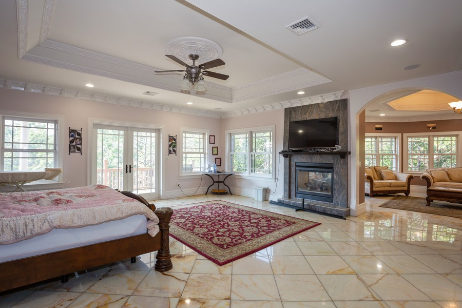 Real Estate Photography - 8 Old Schoolhouse Rd, Manorville, NY, 11949 - Master Bedroom with Fireplace and Sitting Room