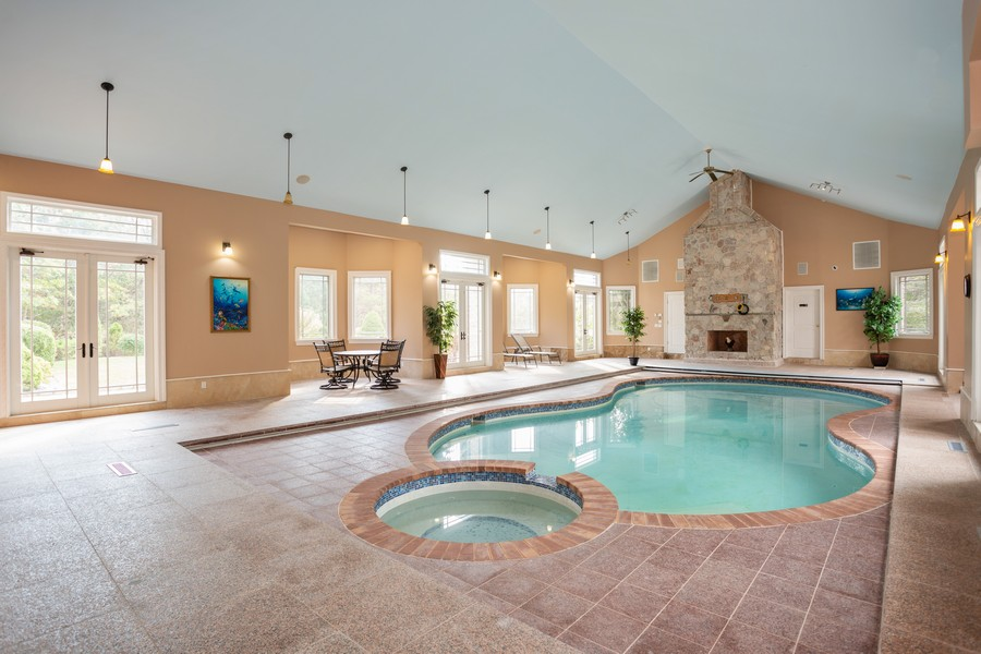 Real Estate Photography - 8 Old Schoolhouse Rd, Manorville, NY, 11949 - Indoor Heated Pool with Fireplace